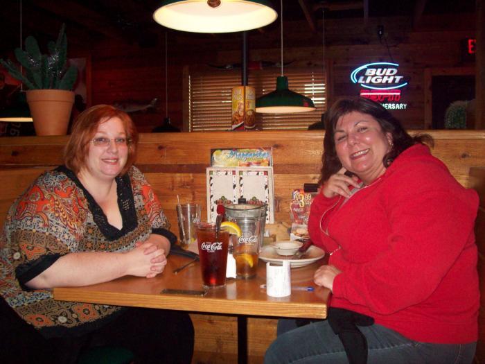 Larissa and Julie, sitting with steak