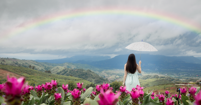 Woman with an umbrella and rainbow