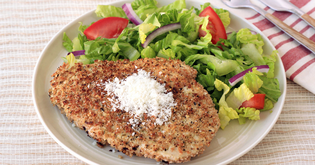 A plate with a serving of Parm-Crusted Chicken 1
